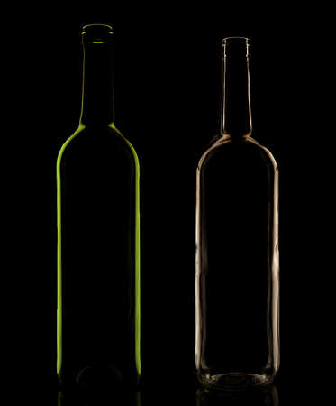 Glass bottle in the low-key lighting and surface reflection, set of two, white and green photo