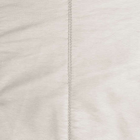 White leather texture with a single seam in the center