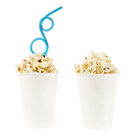 Plastic cup full of popcorn isolated over the white background, set of two, with and without the drinking straw photo