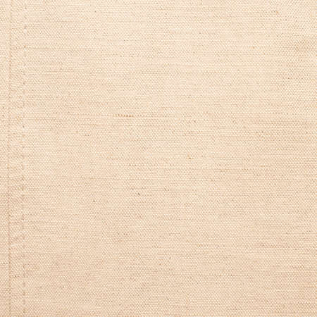 Flaxy white linen cloth texture fragment with one thread seam on the side Stock Photo