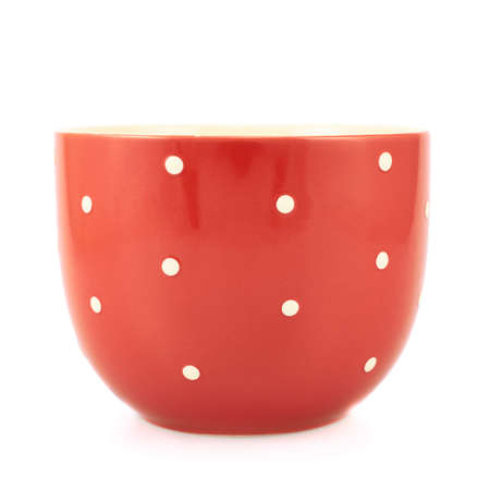 Red polka dot cup, front view, isolated over the white background