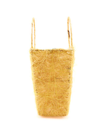 Yellow basket, side view, isolated over the white background photo