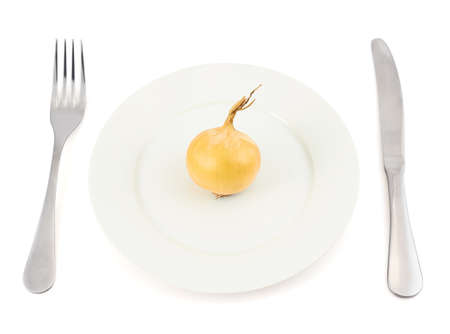 starvation: Onion over white ceramic dish plate with fork and knife isolated over the white background
