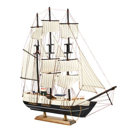 Frigate ship toy model isolated over the white background photo