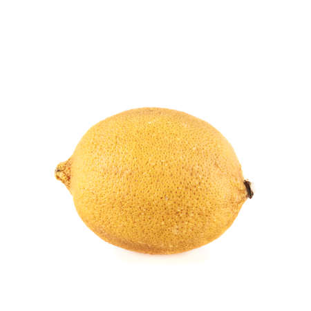 putrefy: Dried old lemon fruit isolated over the white background