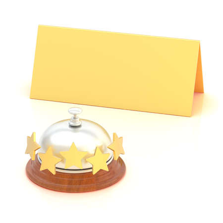 Empty copyspace golden folded paper card behind the five star hotel silver reception bell over the white background photo