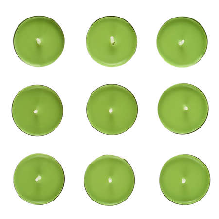 Set of nine green round candles, top view, isolated over the white background photo