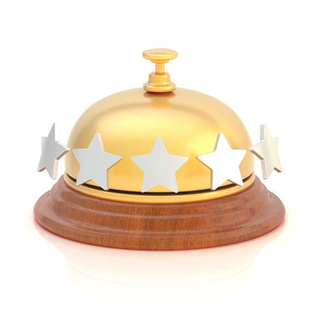 Five star hotel s reception golden bell over the white surface with reflections photo