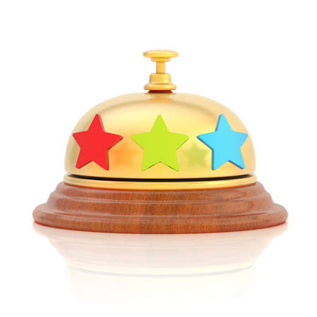 Hotel s reception golden bell with three colorful stars around it, over the white surface with reflections photo