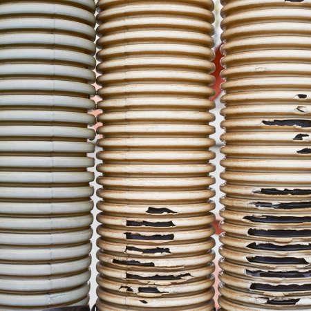 threadbare: Three old and threadbare plastic tubes composition