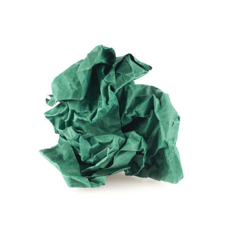 Crumpled piece of green colored paper, isolated over the white background photo