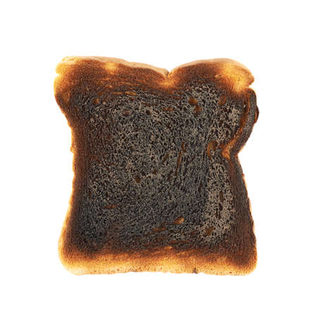 Burnt toast bread slice isolated over the white backround photo