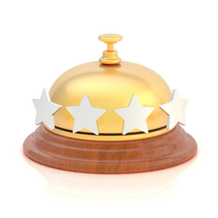 Four star hotels reception golden bell over the white surface with reflections photo