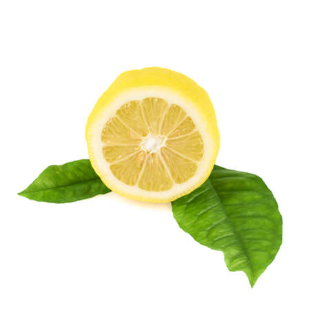 Lemon half over the leaves composition isolated on the white background Stock Photo
