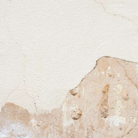 Cracked whitewash wall fragment as a background texture photo