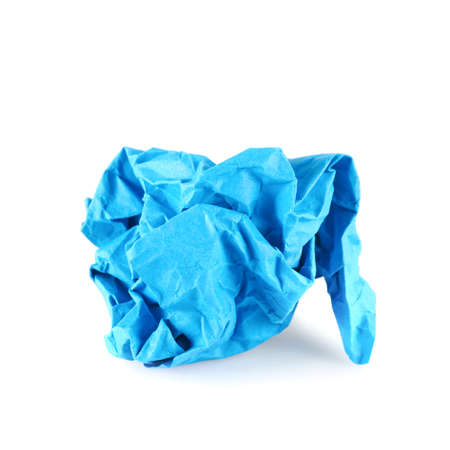 Crumpled piece of blue colored paper, isolated over the white background photo