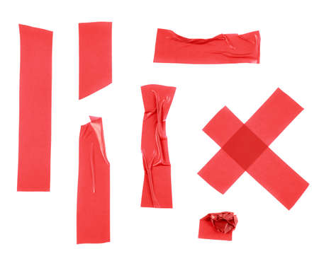 Multiple pieces of red insulating tape of different shapes, isolated over the white background