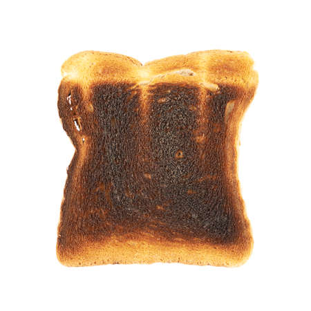 burnt toast: Burnt toast bread slice isolated over the white backrgound