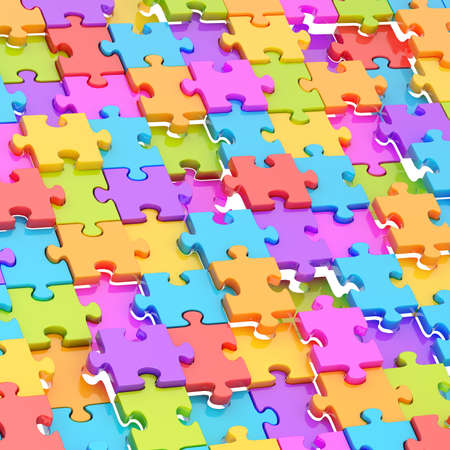 chaotically: Surface chaotically covered with the glossy and colorful puzzle pieces as a background composition Stock Photo