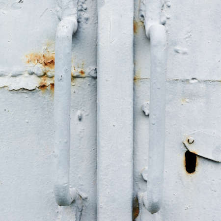 Painted old metal door fragment as a background texture