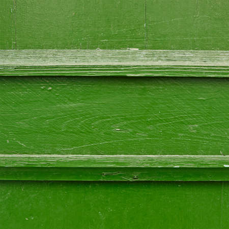 Painted green wooden fence fragment as a background texture photo