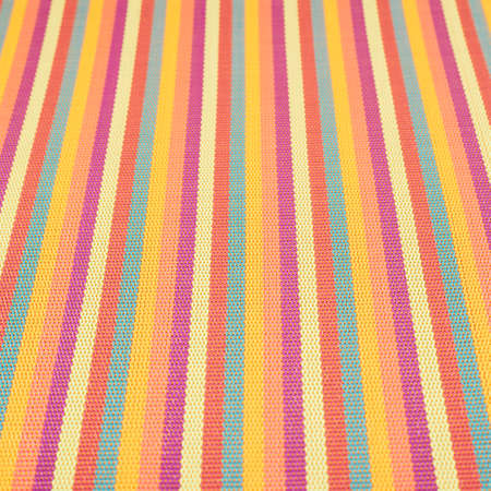 Striped wicker mat fragment as a background, shallow depth of field composition photo