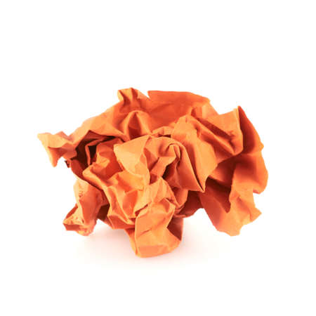 wastrel: Crumpled piece of orange colored paper, isolated over the white background Stock Photo
