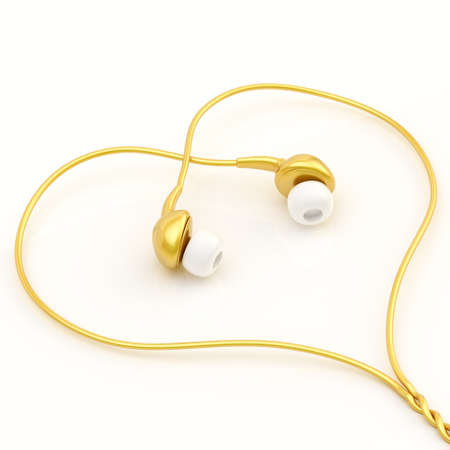In-ear golden headphones forming a heart shape over the white glossy surface