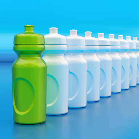 chosen one: Composition of plastic green and white drinking sport bottles arranged in a line, over the blue reflective surface Stock Photo