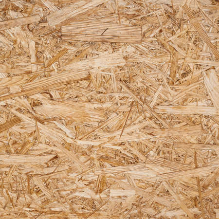 Pressed wood shavings fragment as a background texture