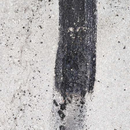Concrete floor fragment with the tire tracks as a background texture photo