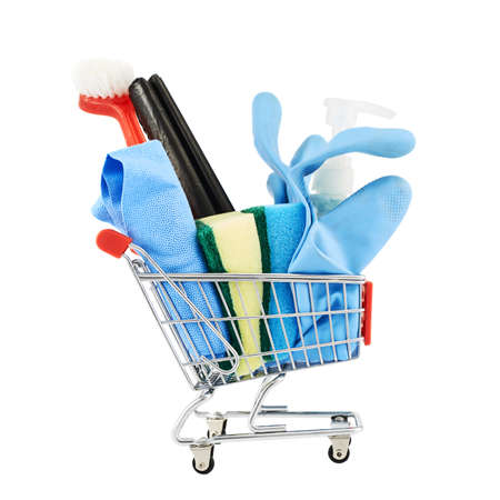 Multiple cleaning instruments in a shopping cart isolated over the white background photo