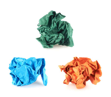 Crumpled piece of colored paper, isolated over the white background, set of three colors photo