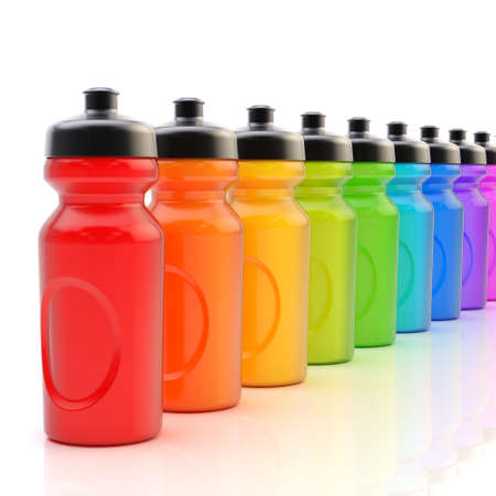 Composition of the rainbow colored plastic drinking sport bottles arranged in a line, over the white reflective surface Reklamní fotografie