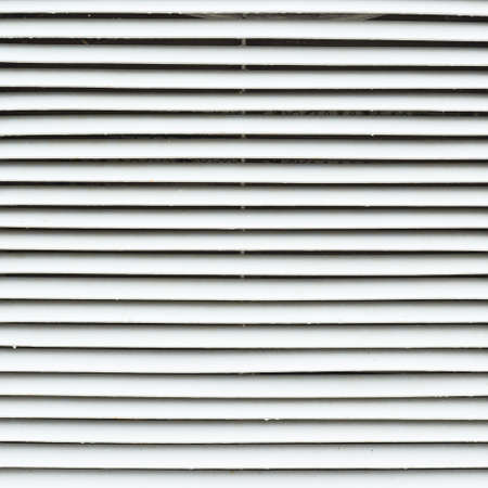 White metal window blinds fragment as an abstract background composition photo