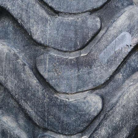 threadbare: Threadbare black old tire surface fragment as an abstract background Stock Photo