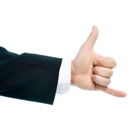 Dressed in a business suit caucasian male hand gesture of be in touch calling sign, high-key light composition isolated over the white background photo