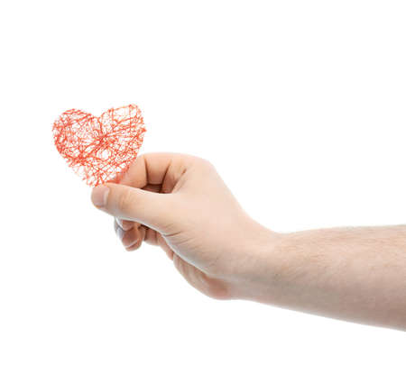 Caucasian male hand holding a red heart shape, high-key light composition isolated over the white background photo