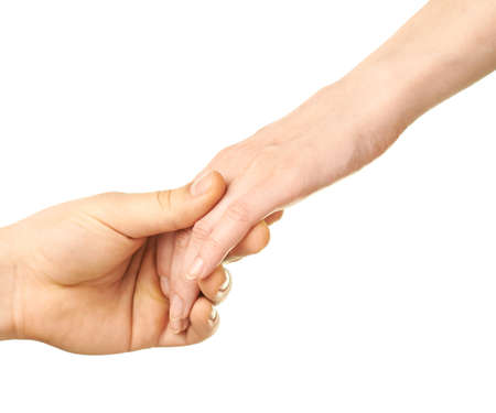 Male and female caucasian hands romantically holding each other isolated over the white background photo
