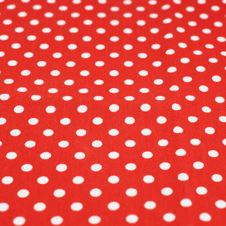 Red fabric with the white polka dots, shallow depth of field composition photo
