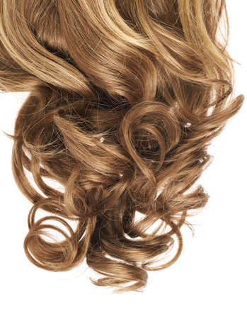 Curly hair fragment placed over the white background as a copyspace backdrop composition photo