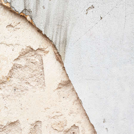 Old grungy concrete wall fragment as an abstract background composition photo