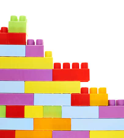 Copyspace background composition made of toy construction brick blocks against the white backdrop photo