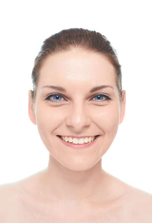 Young caucasian woman portrait with an openly smiling, positive and happy facial expression, isolated over the white background, natural make up and postprocessing photo