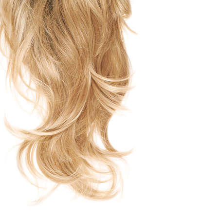 long blonde hair: Wavy hair fragment placed over the white background as a copyspace backdrop composition Stock Photo