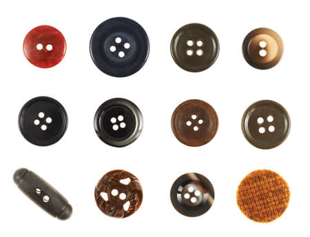 Set of multiple sew-through cloth buttons isolated over the white background photo