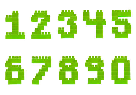 Set of numbers made of green plastic toy construction building bricks isolated over the white background photo