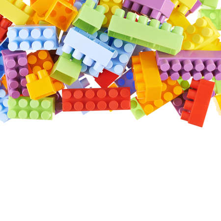 compostion: Pile of colorful plastic toy construction bricks isolated over the white as a copyspace background compostion Stock Photo