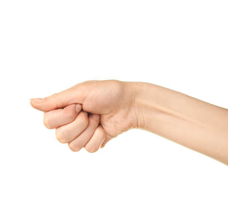 Female caucasian hand gesture of a clenched palm isolated over the white background photo