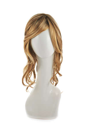 hair conditioner: Wavy hair wig over the white plastic mannequin head isolated over the white background